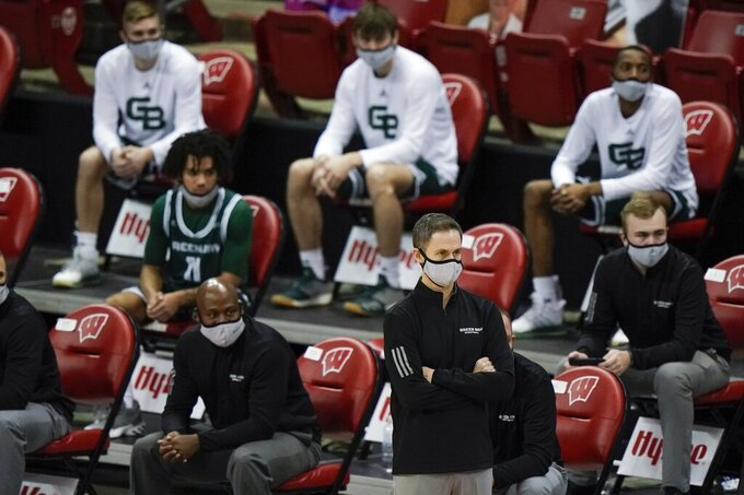 Wisconsin-Green Bay head coach Will Ryan watches during the first half of an NCAA college basketball game against Wisconsin Tuesday, Dec. 1, 2020, in Madison, Wis. (AP Photo/Morry Gash)