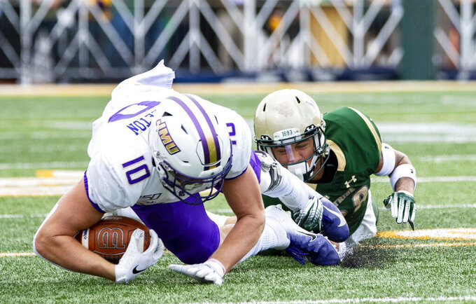 William & Mary's Latrelle Smith (28) brings down James Madison's Riley Stapleton (10) during the first half of an NCAA college football game in Williamsburg, Va., on Saturday, Oct. 19, 2019. (Mike Caudill/The Virginian-Pilot via AP)