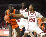 Oklahoma St forward Yor Anei (14) tries to keep the ball away from Oklahoma guard Jamal Bieniemy (24) during the first half of an NCAA college basketball game in Norman, Okla., Saturday, Feb. 1, 2020. (AP Photo/Kyle Phillips)