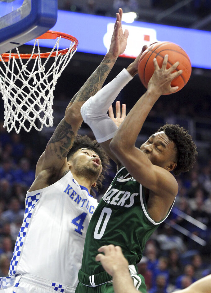 UAB's Tyreek Scott-Grayson, right, pulls down a rebound near Kentucky's Nick Richards (4) during the first half of an NCAA college basketball game in Lexington, Ky., Friday, Nov. 29, 2019. (AP Photo/James Crisp)