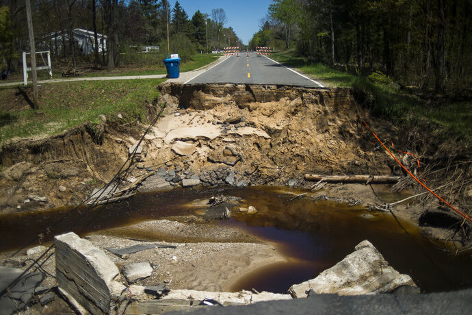 A portion of Jones Road in Billings, Mich., is completely gone Thursday, May 21, 2020, after it was decimated by flooding caused by dam failures. (Katy Kildee/Midland Daily News via AP)