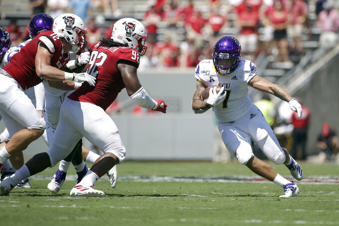 East Carolina running back Darius Pinnix Jr. (7) runs the ball while North Carolina State defensive tackle Larrell Murchison (92) looks for the tackle during the first half of an NCAA college football game in Raleigh, N.C., Saturday, Aug. 31, 2019. (AP Photo/Gerry Broome)