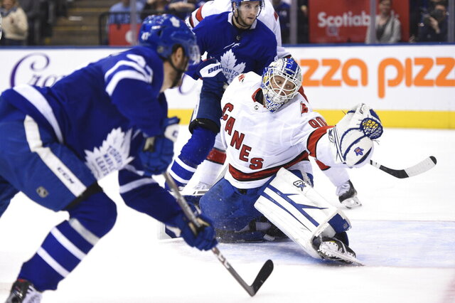 Toronto Maple Leafs left wing Pierre Engvall (47) scores his team's third goal of the game against Carolina Hurricanes emergency goalie David Ayres (90) during second-period NHL hockey game action in Toronto, Saturday, Feb. 22, 2020. (Frank Gunn/The Canadian Press via AP)