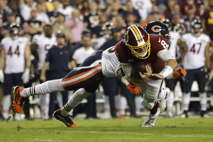 Washington Redskins quarterback Case Keenum (8) is sacked by Chicago Bears safety Eddie Jackson (39) during the first half of an NFL football game Monday, Sept. 23, 2019, in Landover, Md. (AP Photo/Julio Cortez)