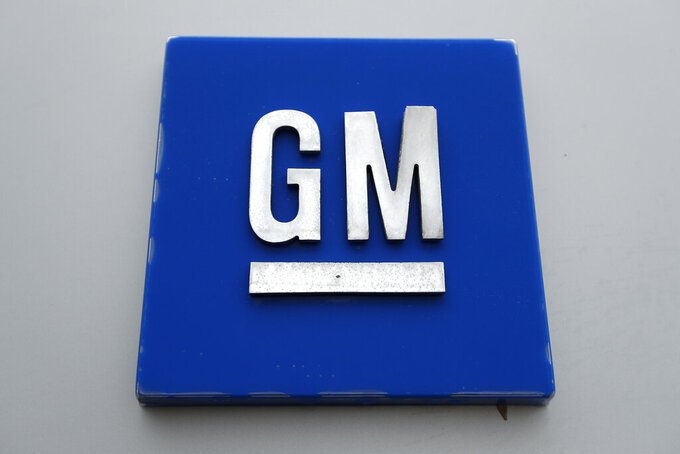 FILE - This Jan. 27, 2020 file photo shows a General Motors logo at the General Motors Detroit-Hamtramck Assembly plant in Hamtramck, Mich. General Motors now says it will support efforts by the United Auto Workers union to organize employees at two U.S. electric vehicle battery factories that it's building in Ohio and Tennessee with a joint-venture partner. The company's statement Tuesday, May 25, 2021 about the plants departs from its past stance that the joint venture, called Ultium LLC, would decide on a bargaining strategy. (AP Photo/Paul Sancya, File)