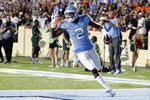 North Carolina's Dyami Brown (2) celebrates as he crosses the goal line on a long touchdown reception against Miami during the first quarter of an NCAA college football game in Chapel Hill, N.C., Saturday, Sept. 7, 2019. (AP Photo/Chris Seward)