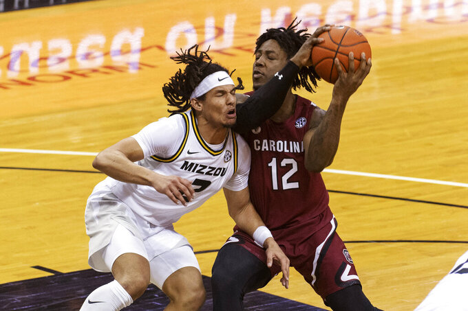 South Carolina's Trae Hannibal, right, runs into Missouri's Drew Buggs during the first half of an NCAA college basketball game Tuesday, Jan. 19, 2021, in Columbia, Mo. (AP Photo/L.G. Patterson)