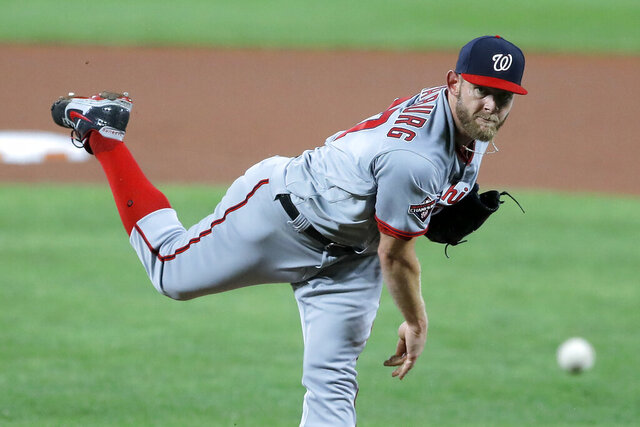 Washington Nationals starting pitcher Stephen Strasburg throws a pitch to the Baltimore Orioles during the first inning of a baseball game, Friday, Aug. 14, 2020, in Baltimore. (AP Photo/Julio Cortez)