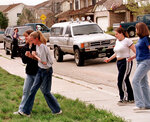 FILE - In this April 20, 1999, file photo, students from Columbine High School are led away from the facility after two gunmen went on a shooting rampage, in the southwest Denver suburb of Littleton, Colo. Twelve students and one teacher were killed in a murderous rampage at the school on April 20, 1999, by two students who killed themselves in the aftermath. (AP Photo/David Zalubowski, File)