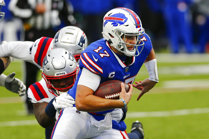 Buffalo Bills quarterback Josh Allen (17) is tackled by New England Patriots' Ja'Whaun Bentley (51) during the second half of an NFL football game Sunday, Nov. 1, 2020, in Orchard Park, N.Y. (AP Photo/John Munson)