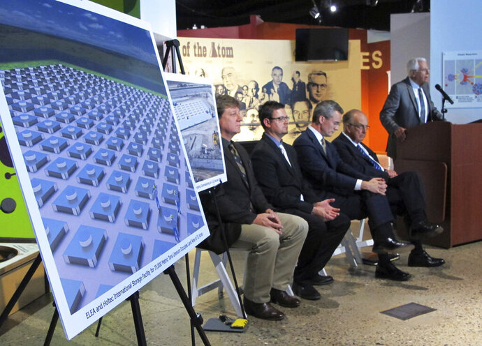 FILE - In this April 29, 2015, file photo, an illustration depicts a planned interim storage facility for spent nuclear fuel in southeastern New Mexico as officials announce plans to pursue the project during a news conference in Albuquerque, N.M. The state of New Mexico is strongly objecting to a recommendation by federal nuclear regulators that a license be granted to build a multibillion-dollar storage facility for spent nuclear fuel from commercial power plants around the U.S. State officials in a letter submitted Tuesday, Sept. 22, 2020, to the Nuclear Regulatory Commission said the site is geologically unsuitable and regulators have failed to consider environmental justice concerns. (AP Photo/Susan Montoya Bryan, File)