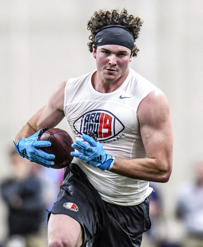 Tight end Dawson Knox runs upfield after catching a pass during Mississippi's Pro Day at the Manning Center in Oxford, Miss., Friday, March 29, 2019. (Bruce Newman/The Oxford Eagle via AP)