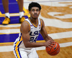 FILE - In this Feb. 13, 2021, file photo, LSU guard Cameron Thomas (24) shoots a free throw in the second half an NCAA college basketball game against Tennessee in Baton Rouge, La. Thomas is a member of The Associated Press All-SEC team in voting announced Tuesday, March 9, 2021. (AP Photo/Gerald Herbert, File)
