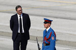 FILE - In this Saturday, Oct. 19, 2019 file photo, Serbian President Aleksandar Vucic, left, waiting for Russian Prime Minister Dmitry Medvedev prior a military parade at the military airport Batajnica, near Belgrade, Serbia. Serbia is considering buying a modern Chinese air defense missile system, the Serbian president said Tuesday, Aug. 11, 2020 despite a warning by the United States that such deals with Beijing could jeopardize the Balkan country's proclaimed European Union membership goals. Serbian president Aleksandar Vucic said that
