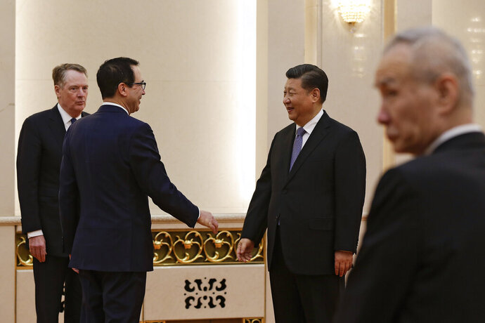 U.S. Treasury Secretary Steven Mnuchin, second from left, talks with Chinese President Xi Jinping as U.S. Trade Representative Robert Lighthizer, left, and Chinese Vice Premier Liu He, right, look on before their meeting at the Great Hall of the People in Beijing, Friday, Feb. 15, 2019. (AP Photo/Andy Wong, Pool)
