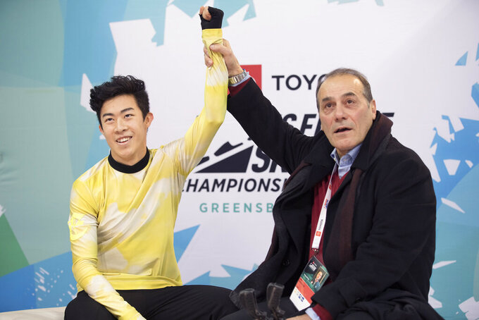 Nathan Chen with coach Raf Arutunian learn Chen's score after his the men's senior free skate program at the U.S. Figure Skating Championships, Sunday, Jan. 26, 2020, in Greensboro, N.C. (AP Photo/Lynn Hey)