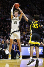Purdue center Matt Haarms (32) shoots over Iowa forward Cordell Pemsl (35) during the second half of an NCAA college basketball game in West Lafayette, Ind., Wednesday, Feb. 5, 2020. Purdue defeated Iowa 104-68. (AP Photo/Michael Conroy)