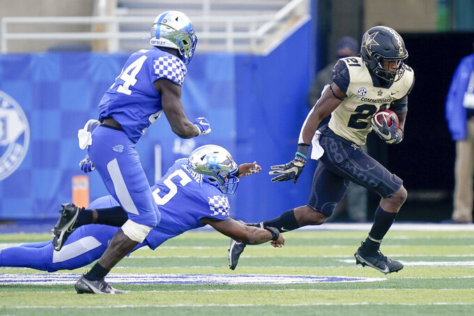 Vanderbilt linebacker Kenny Hebert (21) runs with the ball during the second half of an NCAA college football game against Kentucky, Saturday, Nov. 14, 2020, in Lexington, Ky. (AP Photo/Bryan Woolston)