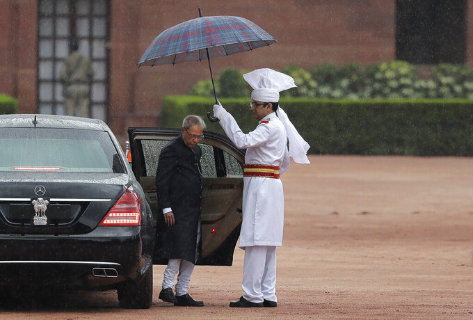 FILE- In this Tuesday, July 25, 2017, file photo, India's former President Pranab Mukherjee arrives for a joint services guard of honour before leaving Presidential palace after swearing in ceremony of new president Ram Nath Kovind in New Delhi, India. Former President Pranab Mukherjee, who was a key troubleshooter in managing fractious coalitions as a member of India's long-governing Congress party died Monday evening. He was 84. Mukherjee had emergency surgery for a blood clot in his brain on August 10 at New Delhi's Army Hospital Research and Referral. (AP Photo/Manish Swarup,file)