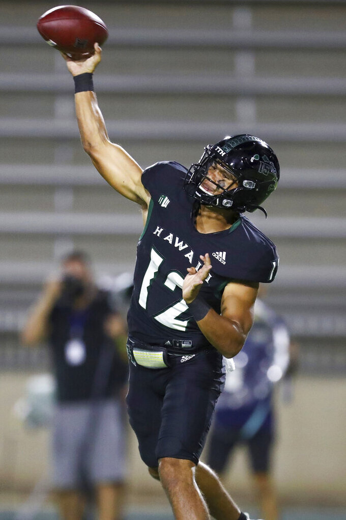 Hawaii quarterback Chevan Cordeiro (12) throws a pass downfield during the second half of an NCAA college football game against Portland State, Saturday, Sept. 4, 2021, in Honolulu. (AP Photo/Darryl Oumi)