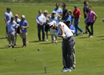 Dustin Johnson hits an approach shot on the first hole during the first round of the U.S. Open Golf Championship, Thursday, June 14, 2018, in Southampton, N.Y. (AP Photo/Julio Cortez)