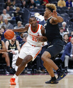Clemson's Aamir Simms (25) drives around Colorado's D'Shawn Schwartz (5) during the first half on an NCAA college basketball game, Tuesday, Nov. 26, 2019, in Las Vegas. (AP Photo/John Locher)