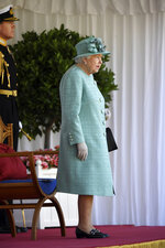 Britain's Queen Elizabeth II attends a ceremony to mark her official birthday at Windsor Castle in Windsor, England, Saturday June 13, 2020. Queen Elizabeth II's birthday is being marked with a smaller ceremony than usual this year, as the annual Trooping the Color parade is canceled amid the coronavirus pandemic. The Queen celebrates her 94th birthday this year. (Toby Melville/Pool via AP)