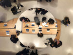 FILE - In this Nov. 10, 2019, file photo Looking down through skylights above Apple's flagship store on Fifth Avenue, customers browse and examine various Apple products in New York. Apple reports financial earns on Tuesday, Jan. 28, 2020. (AP Photo/Julie Jacobson, File)