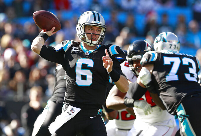 "FILE - Carolina Panthers' Taylor Heinicke (6) looks to pass against the Atlanta Falcons during the first half of an NFL football game in Charlotte, N.C., in this Sunday, Dec. 23, 2018, file photo. Taylor Heinicke was taking advanced math classes online at Old Dominion University when Washington called him to be ""quarantine quarterback."" Until a relief appearance Sunday, Dec. 27, 2020, he hadn't played an NFL game since 2018 and was an XFL backup, and now Heinicke could start or be one Alex Smith injury away in the season finale at Philadelphia with the NFC East on the line. (AP Photo/Jason E. Miczek, File)"