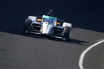 Fernando Alonso, of Spain, drives into turn one during a practice session for the Indianapolis 500 auto race at Indianapolis Motor Speedway, Sunday, Aug. 16, 2020, in Indianapolis. (AP Photo/Darron Cummings)