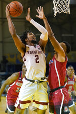 Stanford guard Bryce Wills (2) shoots against Arizona guard Jemarl Baker Jr. during the second half of an NCAA college basketball game in Santa Cruz, Calif., Saturday, Dec. 19, 2020. (AP Photo/Jeff Chiu)