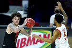 Nebraska guard Teddy Allen, left, looks for an open teammate against Maryland guard Eric Ayala during the second half of an NCAA college basketball game, Tuesday, Feb. 16, 2021, in College Park, Md. Maryland won 64-50. (AP Photo/Julio Cortez)