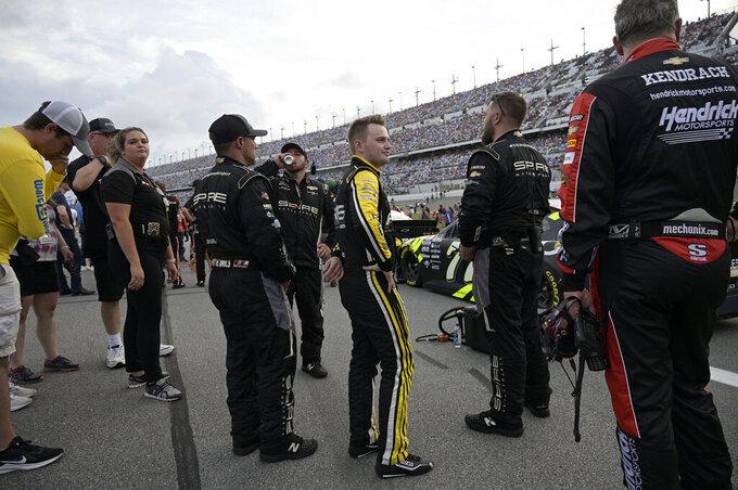 Driver Justin Haley, center, stands on pit road before a NASCAR Cup Series auto race at Daytona International Speedway, Saturday, Aug. 28, 2021, in Daytona Beach, Fla. (AP Photo/Phelan M. Ebenhack)