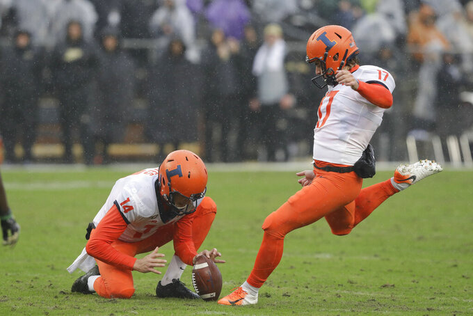 Illinois place kicker James McCourt (17) kicks a field goal out of the hold of punter Blake Hayes (14) during the first half of an NCAA college football game against the Purdue, Saturday, Oct. 26, 2019, in West Lafayette, Ind. (AP Photo/Darron Cummings)