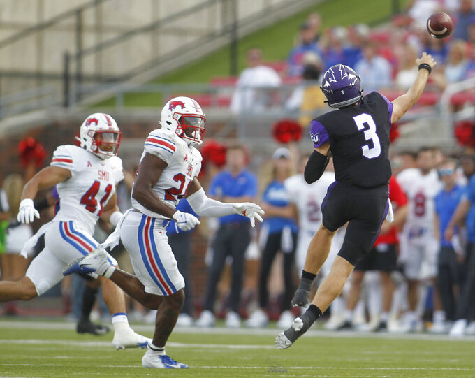 Abilene Christian Uquarterback Stone Earle (3) gets off a pass under pressure from SMU linebackers Jimmy Phillips Jr. (24) and Isaac Slade-Matautia (41) during the first quarter of an NCAA college football game Saturday, Sept. 4, 2021, in Dallas. (Steve Hamm/The Dallas Morning News via AP)