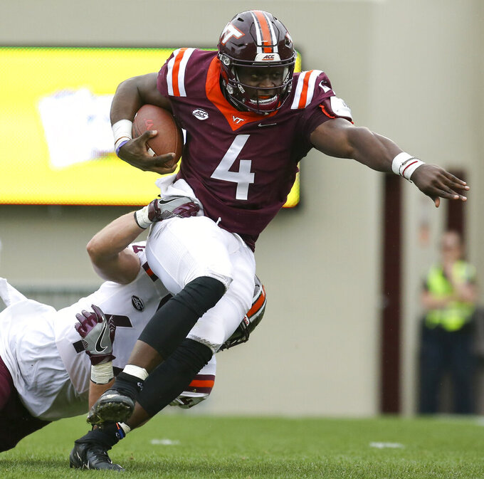 Virginia Tech quarterback Quincy Patterson II (4) gets tackled by linebacker Dax Hollifield during the NCAA college football team's Maroon-White spring game in Blacksburg, Va., Saturday, April 13, 2019. (Matt Gentry/The Roanoke Times via AP)
