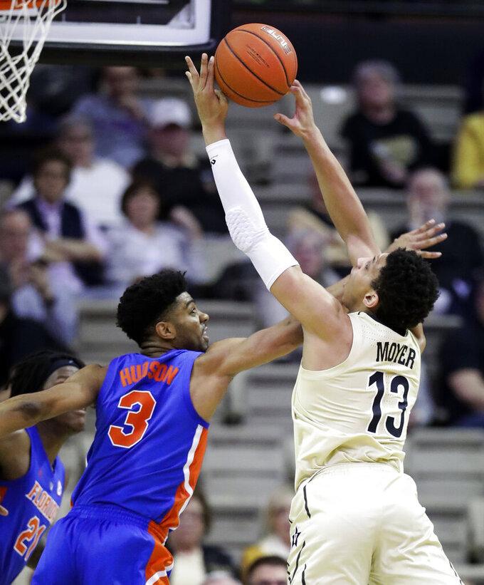 Vanderbilt forward Matthew Moyer (13) and Florida guard Jalen Hudson (3) reach for a rebound during the first half of an NCAA college basketball game Wednesday, Feb. 27, 2019, in Nashville, Tenn. (AP Photo/Mark Humphrey)