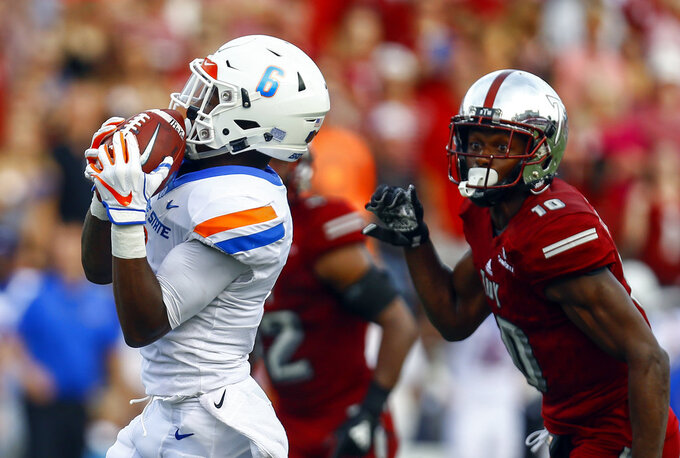 Boise State wide receiver CT Thomas (6) catches a pass over the top of Troy safety Will Sunderland (10) for a touchdown during the first half of an NCAA college football game, Saturday, Sept. 1, 2018, in Troy, Ala. (AP Photo/Butch Dill)