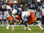 Connecticut wide receiver Ardell Brown (83) is stopped by Illinois defensive back Nate Hobbs (8) and Illinois defensive back Stanley Green (7) during the first half of an NCAA college football game, Saturday, Sept. 7, 2019, in East Hartford, Conn. (AP Photo/Jessica Hill)