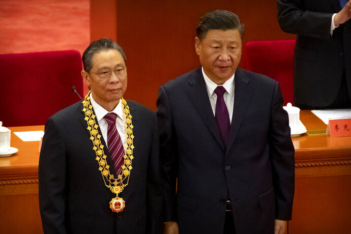 Chinese President Xi Jinping, right, stands with Chinese medical expert Zhong Nanshan after awarding him a medal at an event to honor some of those involved in China's fight against COVID-19 at the Great Hall of the People in Beijing, Tuesday, Sept. 8, 2020. Chinese leader Xi Jinping is praising China's role in battling the global coronavirus pandemic and expressing support for the U.N.'s World Health Organization, in a repudiation of U.S. criticism and a bid to rally domestic support for Communist Party leadership. (AP Photo/Mark Schiefelbein)