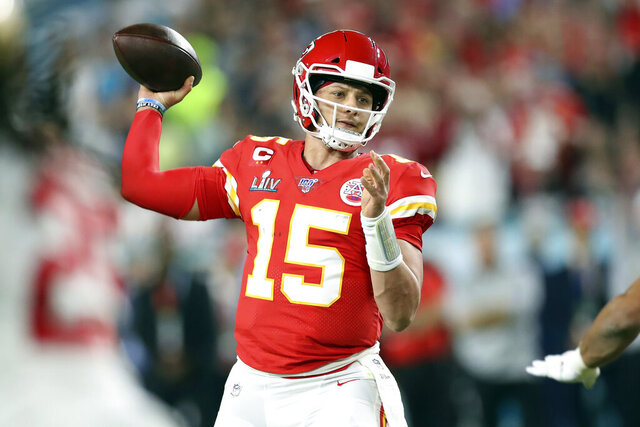 FILE- In this Feb. 2, 2020, file photo, Kansas City Chiefs quarterback Patrick Mahomes (15) throws a pass during Super Bowl 54 against the San Francisco 49ers in Miami Gardens, Fla. The Super Bowl MVP is joining the ownership group of the Kansas City Royals.(AP Photo/Doug Benc, File)