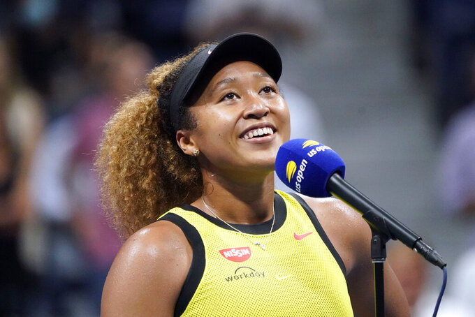 FILE - Naomi Osaka, of Japan, speaks to the crowd after beating Marie Bouzkova, of the Czech Republic, during the first round of the U.S. Open tennis championships in New York, in this Monday, Aug. 30, 2021, file photo. Osaka earned the Wilma Rudolph Courage Award for bringing awareness to social justice and mental health issues at the Annual Salute to Women in Sports on Wednesday night, Oct. 13, 2021, in New York. (AP Photo/Elise Amendola, File)
