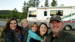 This Sept. 27, 2020 photo released by Breaux Walker, right, shows his family, from left, Edie Silver Walker, Stokes Walker, Mirakel Walker and Reyne Walker on the banks of the Madison River in Yellowstone National Park. n RVs, rental homes and five-star resorts, families untethered by the constraints of physical classrooms for their kids have turned the new school year into an extended summer vacation. (Breaux Walker via AP)