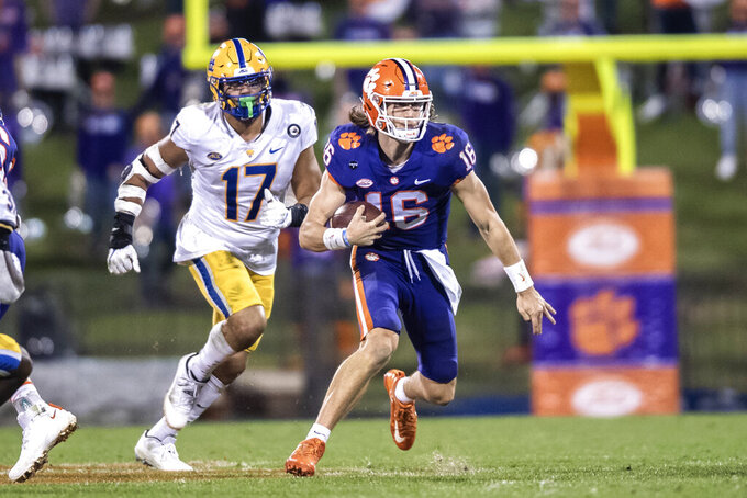 Clemson quarterback Trevor Lawrence (16) runs the ball during the third quarter of an NCAA college football game against Pittsburgh in Clemson, S.C., Saturday, Nov. 28, 2020. (Ken Ruinard/The Independent-Mail via AP, Pool)c