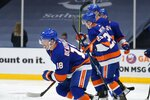 New York Islanders' Anthony Beauvillier (18) smiles as he skates back to his team's bench after scoring a goal during the second period of an NHL hockey game against the New York Rangers, Saturday, May 1, 2021, in Uniondale, N.Y. (AP Photo/Frank Franklin II)