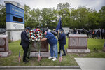 A motorcade of veterans stops outside the VA Medical Center as wreaths are laid beside memorial stones on the premises, Monday, May 25, 2020, in the Brooklyn borough of New York. (AP Photo/John Minchillo)