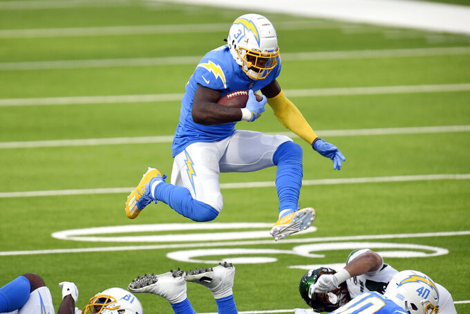 Los Angeles Chargers running back Kalen Ballage leaps for yardage against the New York Jets during the first half of an NFL football game Sunday, Nov. 22, 2020, in Inglewood, Calif. (AP Photo/Kyusung Gong)
