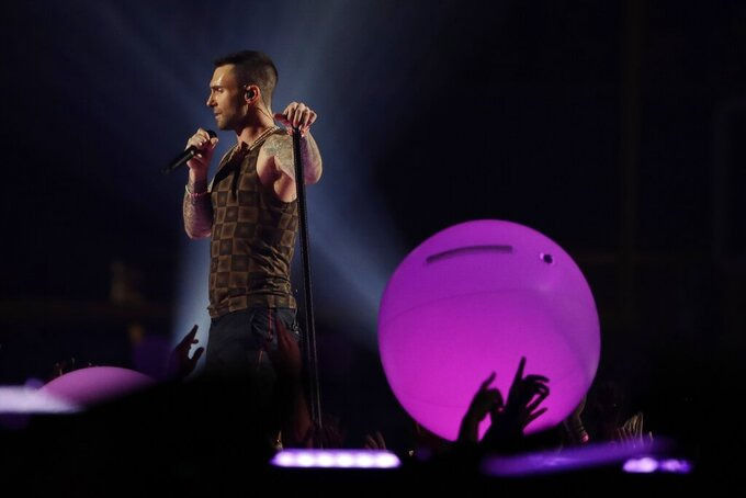 Adam Levine of Maroon 5 performs during halftime of the NFL Super Bowl 53 football game between the Los Angeles Rams and the New England Patriots Sunday, Feb. 3, 2019, in Atlanta. (AP Photo/Frank Franklin II)