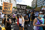 Marchers chant as they gather at Black Lives Matter Plaza near the White House in Washington, during the March on Washington, Friday, Aug. 28, 2020, commemorating the 57th anniversary of the Rev. Martin Luther King Jr.'s