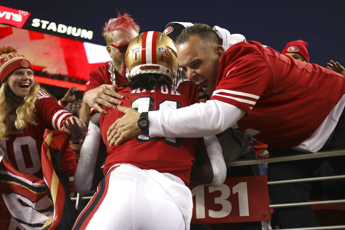 San Francisco 49ers wide receiver Brandon Aiyuk (11) celebrates with fans after scoring against the Green Bay Packers during the second half of an NFL football game in Santa Clara, Calif., Sunday, Sept. 26, 2021. (AP Photo/Jed Jacobsohn)